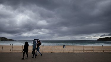 Storm clouds loom over Bondi Beach at the start of an unusually cool weekend.