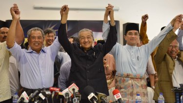 Former Malaysian prime minister Mahathir Mohamad joined with political foes to issue a declaration signed by 58 public figures urging Prime Minister Najib Razak to resign over corruption allegations.
