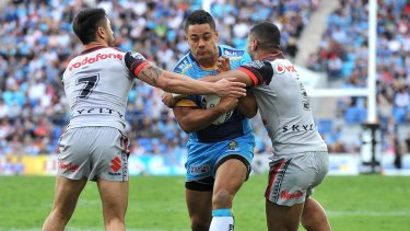 Back in the NRL: Jarryd Hayne takes on the defence in his first run for the Titans during the round 22 NRL match between the Gold Coast and the New Zealand Warriors at Cbus Super Stadium.