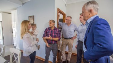 Prime Minister Malcolm Turnbull, Treasurer Scott Morrison and local member David Coleman visited Kim and Julian Mignacca and daughter Addison on Sunday to talk about negative gearing.