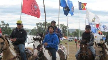 Horseback riders make their way through an encampment near North Dakota's Standing Rock Sioux reservation.