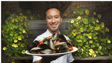 Little Creatures Geelong head chef Stephen Shing holds a plate of mussels served at the brewery restaurant.