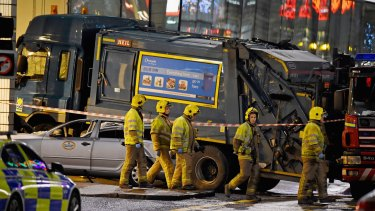 Emergency services attend the scene of the crash in Glasgow.