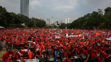 Pro-government demonstrators listen to a speech during the Kuala Lumpur rally.