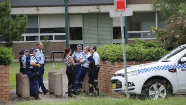 Police gather outside Woolooware High School, which also received a bomb threat.