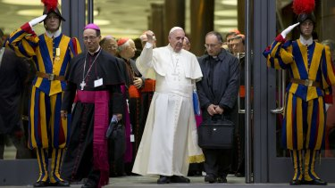 Pope Francis leaves at the end of the afternoon session of the Synod of bishops at the Vatican on Wednesday.