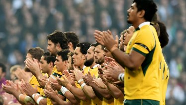 The Wallabies join in the applause in memory of Australian Test cricketer Phillip Hughes.