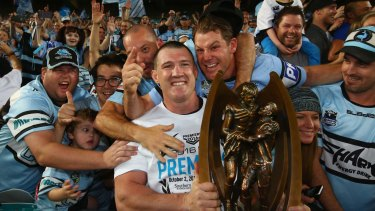 Sweet victory: Paul Gallen is mobbed by Sharks fans after the game.