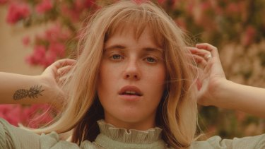 Hallie's latest single is a snub at society's quickness to judge others and the necessity of kindness.
