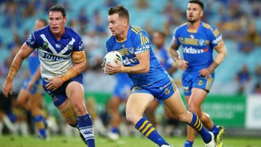 All for nought: Eels winger Clint Gutherson runs the ball during the Eels victory over the Bulldogs on Friday.