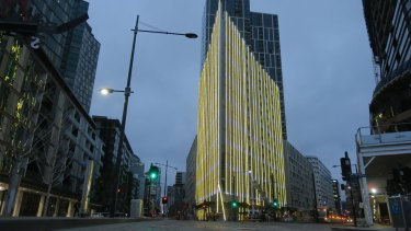 Technicians test the new lighting installation at 888 Collins, Docklands.