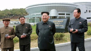North Korean leader Kim Jong Un (second from right) at the newly built National Space Development General Satellite Control and Command Centre.