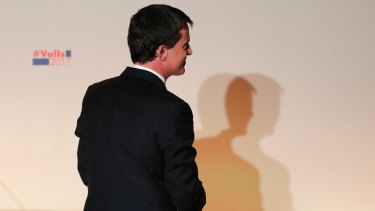 Former socialist Prime Minister Manuel Valls leaves after delivering a speech following his defeat at the French presidential primaries.