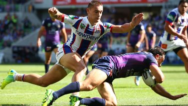 Touching down: Cooper Cronk scores a try against the Newcastle Knights at AAMI Park at April.
