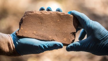 The discovery of this axe sharpening stone inside the Kakadu National Park has rewritten the history of Australia.