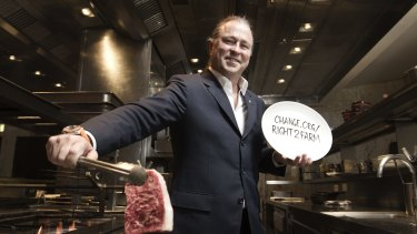 Chef Neil Perry with a raw Blackmore wagyu steak at Rockpool bar and grill.