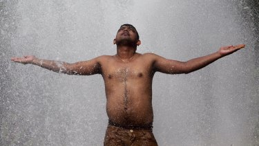 A man cools himself off at a municipal corporation water treatment plant in Agartala, India.