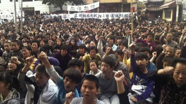 Villagers protest in Wukan village in 2011.