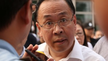 Zhang Yong, deputy head of Tianjin Binhai New District, tries to communicate with protesters on Wednesday.