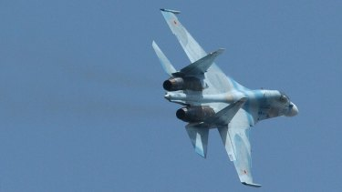 A Russian Sukhoi SU-30 fighter. In recent weeks, Russia has deployed more than two dozen fighter aircraft, attack helicopters and surface-to-air missile defence systems to a base in Syria, according to US officials.