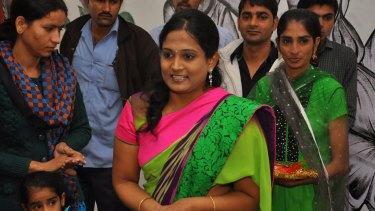 Kriti Bharti receiving an award for her work.