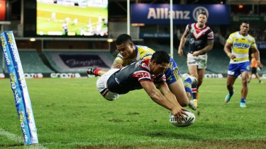 Touchdown: Roger Tuivasa-Sheck dives over to score a try in the corner.