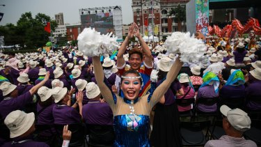Performers walk past attendees during Tsai Ing-wen's inauguration ceremony on Friday.