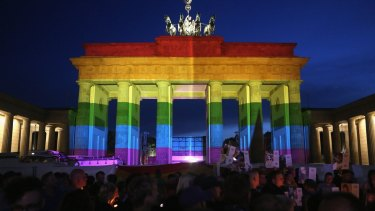 The Brandenburg Gate in Germany is seen with a rainbow flag projected onto it during a vigil for victims of the Orlando, Florida nightclub shooting.