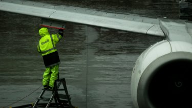 Qantas has forecast that its fuel bill will be lower this year but its passengers still face fuel surcharges.