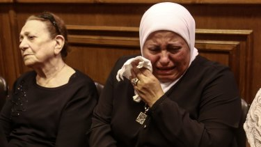 Friends and relatives of EgyptAir hostess Yara Hani mourn last month.