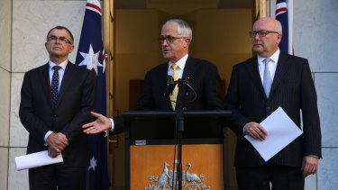 Prime Minister Malcolm Turnbull and Attorney-General George Brandis at last week's announcement naming Brian Martin as the commissioner.