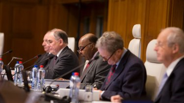 Thomas Mensah, centre, president of the five judge tribunal ruling on the arbitration case between the Philippines and China in the South China Sea.