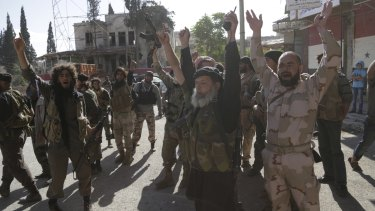 Nusra Front members celebrate in the north-western Syrian city of Ariha last year.