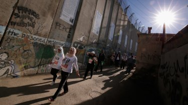 The Palestine Marathon's route alongside the Israeli-built separation wall near the occupied West Bank city of Bethlehem on April 1.
