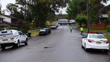 Police at a crime scene on Sir Thomas Mitchell Drive in Davidson where a family of four have been found dead in their home