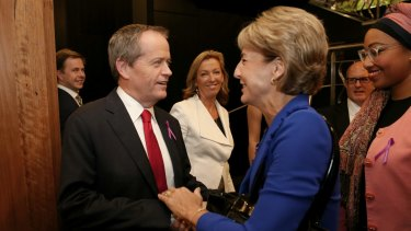 Opposition Leader Bill Shorten greets Senator Michaela Cash, Minister Assisting the Prime Minister for Women, at the National Press Club on Wednesday.