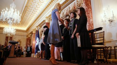 Ivanka Trump shakes hands with people honoured for their work to stop human trafficking including Allison Lee, of Taiwan, and Boom Mosby, of Thailand, right, during a 2017 Trafficking in Persons Report ceremony at the State Department, on Tuesday.