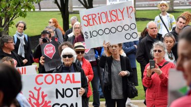 Protesters outside a Melbourne mining conference campaigned against the Carmichael coal mine project.