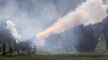 A 21-gun salute is fired near a coffin carrying the remains of Richard III near Leicester.