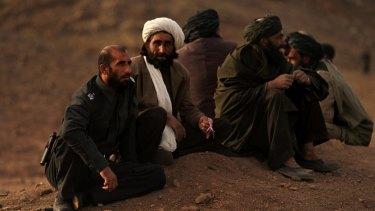 Former Oruzgan police chief Matiullah Khan (left), talks with local men in Tarin Kowt.