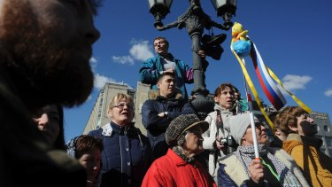 A woman holds up a yellow duck toy during protests in downtown Moscow on the weekend.