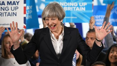 British Prime Minister Theresa May smiles as the Conservative election campaign resumes on June 5.