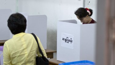 National League for Democracy leader Aung San Suu Kyi casts her vote in Yangon.