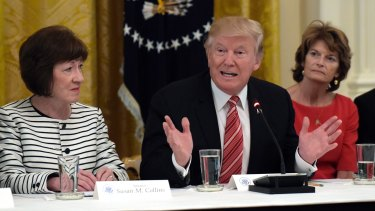 US President Donald Trump, centre, meets with Republican senators on healthcare in June, Republican Senator Susan Collins, left, argues that the legislation is too hard on Americans.