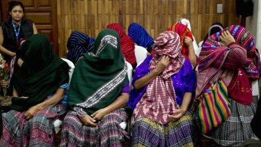 Victims of sexual violence hide their faces during the trial against former military officer and a former paramilitary fighter convicted of sexual violence against indigenous women during Guatemala's civil war, in Guatemala City.