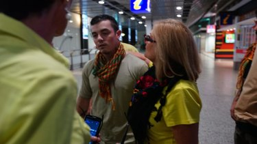 Julia Dyball and Michele Harding greet anti-Islamic State fighter Ashley Dyball who  returned to Melbourne on Monday 7 December 2015. Photo: Luis Ascui