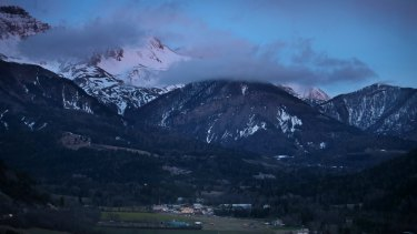 Night falls on the alps near the area where the plane crashed.