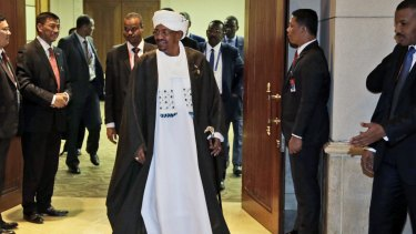 Sudan's President Omar al-Bashir leaves after a bilateral meeting with Indonesian President Joko Widodo on the sidelines of  the Organisation of Islamic Cooperation (OIC) summit in Jakarta.