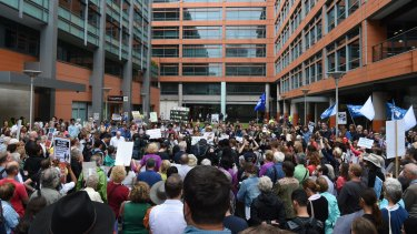 Hundreds protest in front of the Department of Immigration in Sydney.