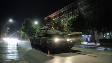 Turkish army tanks move in the main streets of Ankara in the early morning hours of  Saturday.